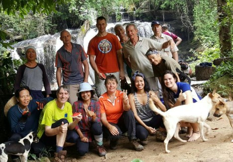 The group photo, including waterfall and some dogs. Photo by Chan
